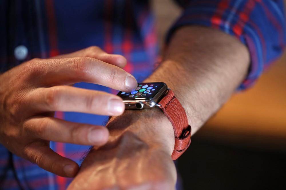 Apple Watch Wrist Touch Red Blue Shirt.jpg